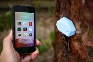 Smartphone shown in close proximity to beacon technology