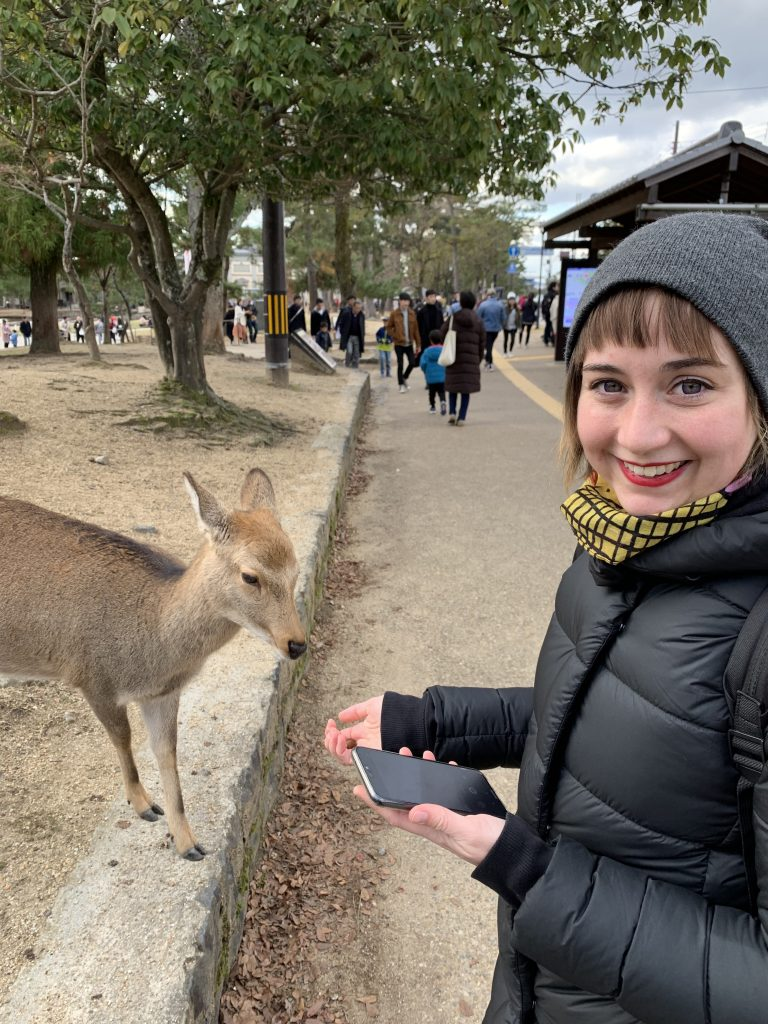 Deer eating out of Shyla's hand