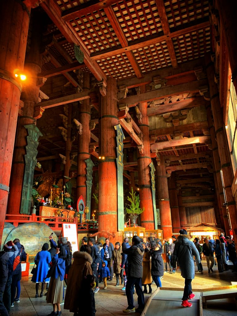 Inside of Todai-ji temple with tourists