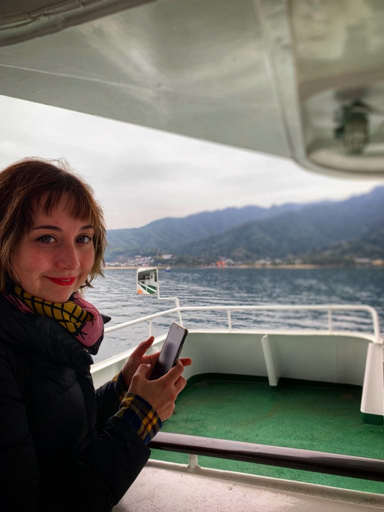 Frizzy haired Shyla taking photos from the ferry