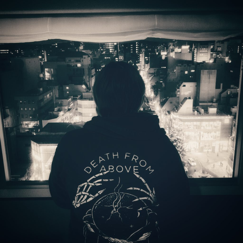 Shyla in front of our hotel window in her Death From Above hoodie