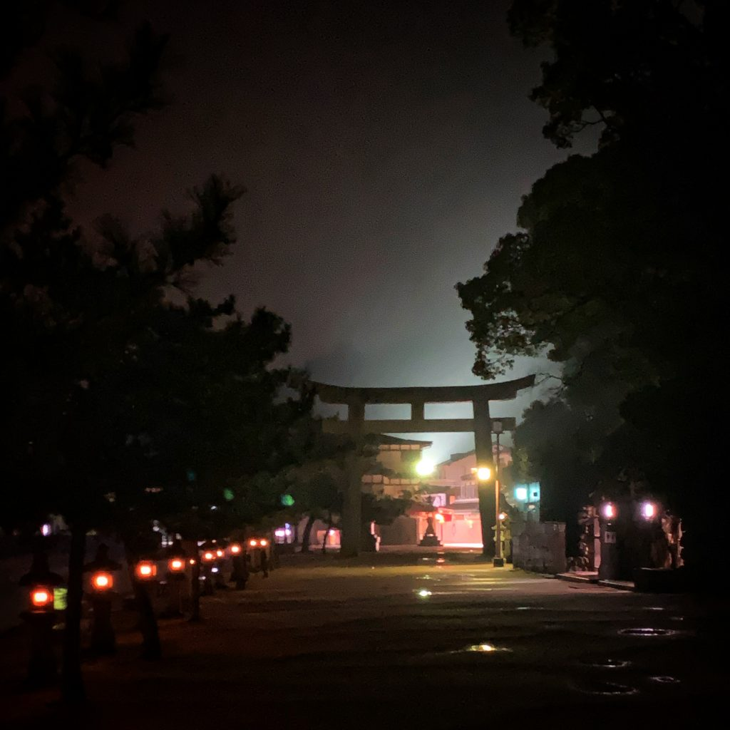 Night time photo of a Japanese gate