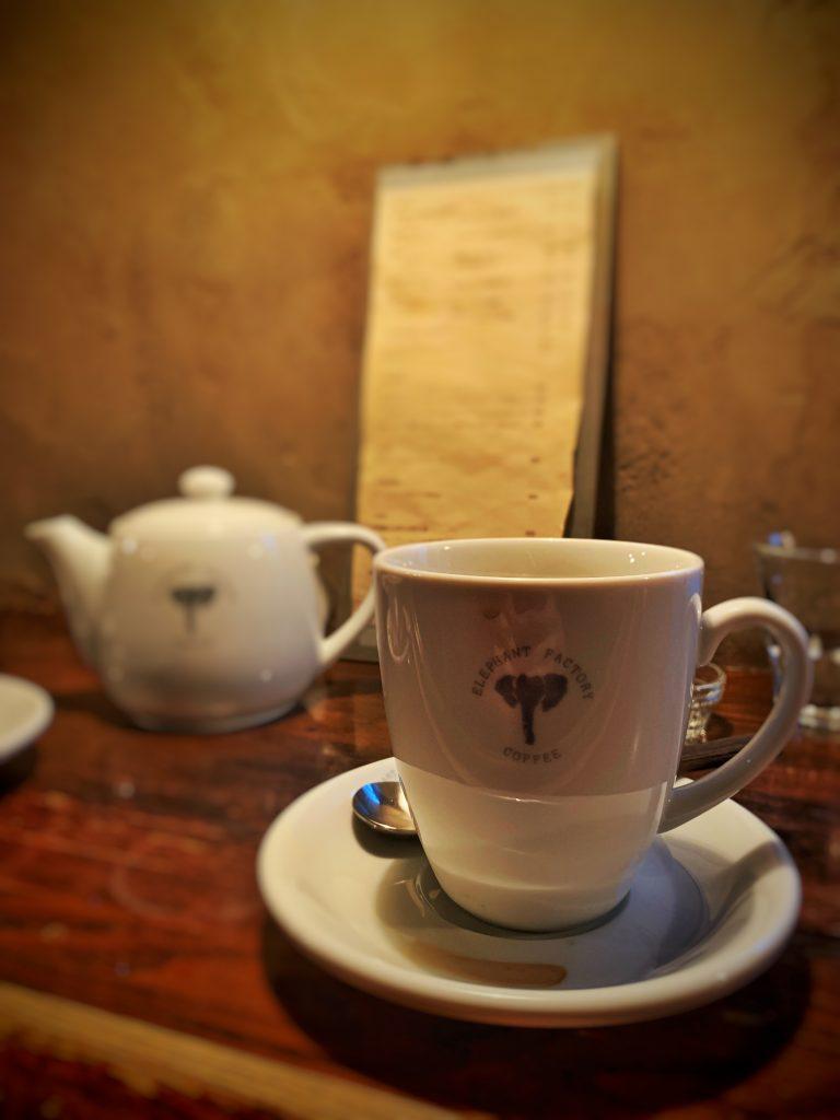 Coffee mug in front of menu