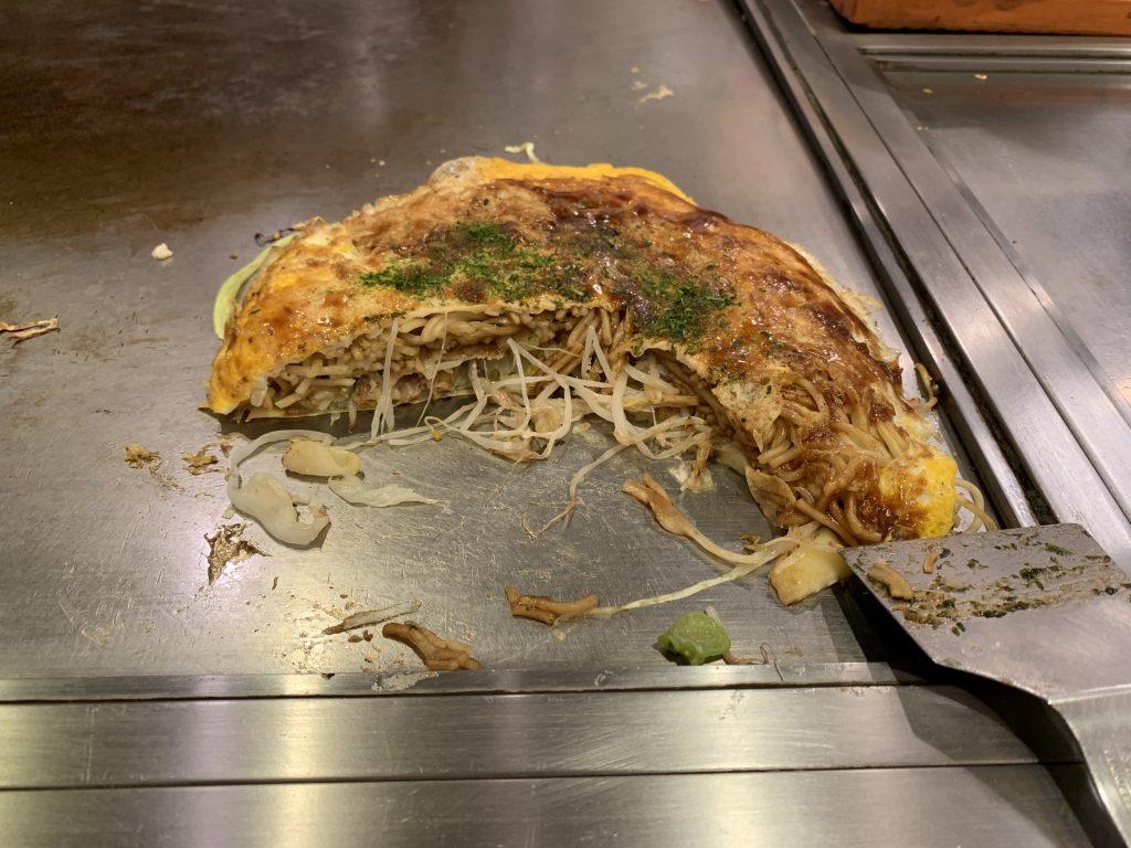 Okonomiyaki being eaten