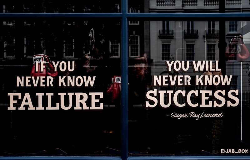 """Photo of a window with the quote from Sugar Ray Leonard, """"If you never know failure, you will never know success""""."""